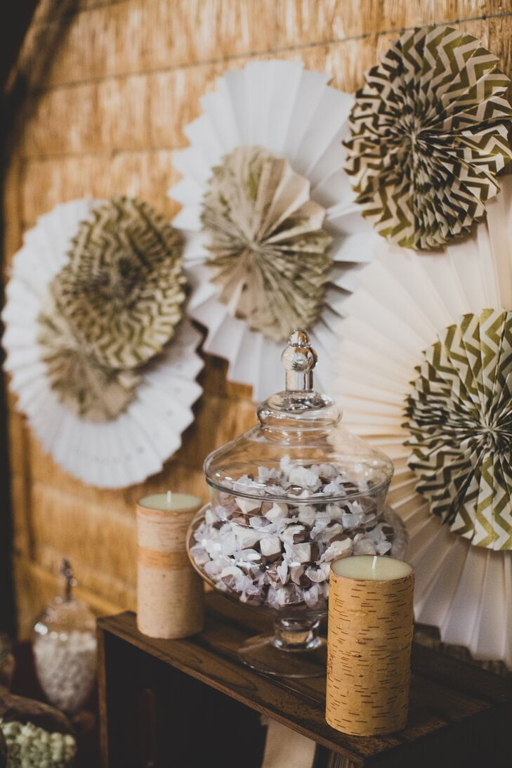 """For wedding favors, guests selected a brown paper bag stamped with """"Thank You"""" and filled it up with a variety of five different types of candy in glass jars."""