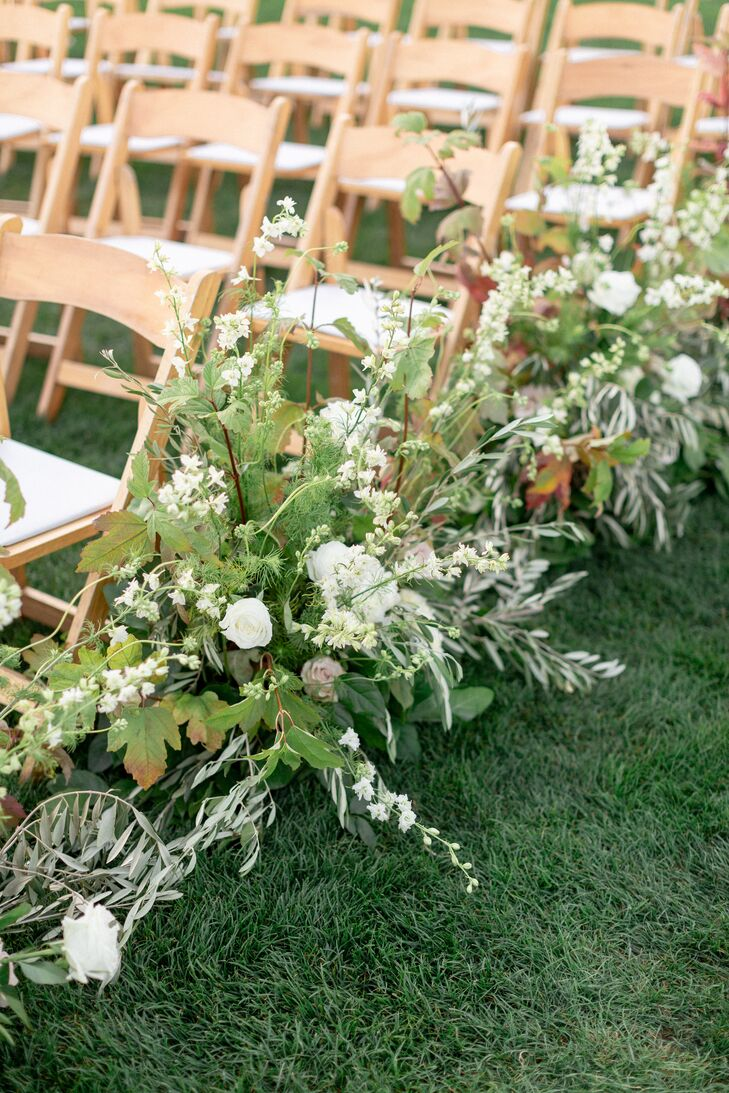 Aisle Decorations with Roses and Greenery