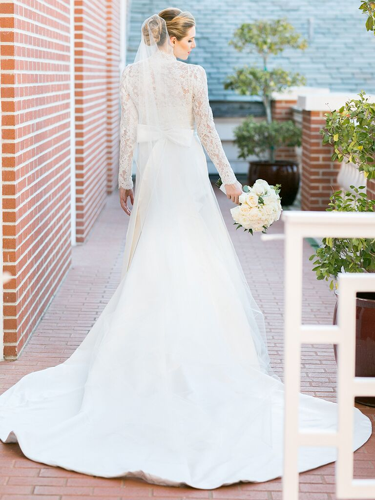 Romantic wedding dress with long sleeves, bow detail and lace back