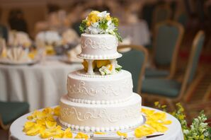 White Wedding Cake With Yellow Rose Petals