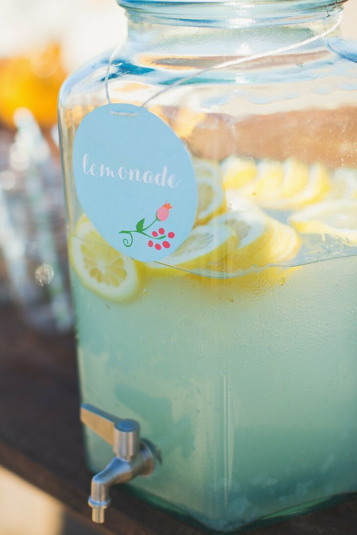 Guests sipped on cool summertime lemonade served in large classic glass drink dispensers.