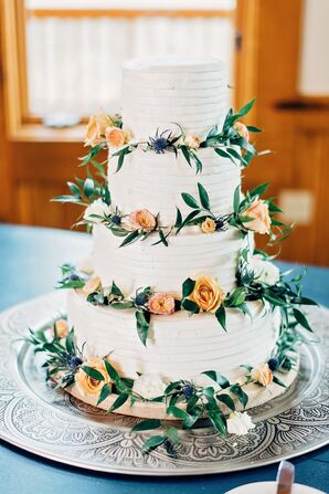 Classic Wedding Cake with Flowers and Greenery