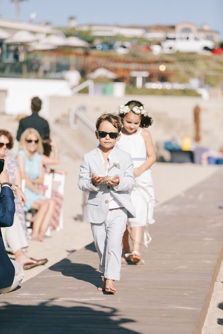 Flower girls and the ring bearer were outfitted with sunglasses and beachy, light-toned apparel.