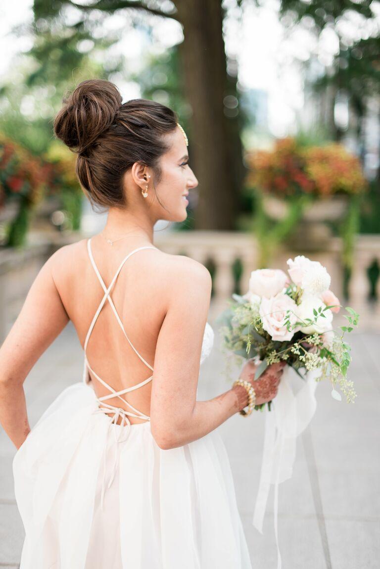 Braided ballerina bun wedding updo for long hair