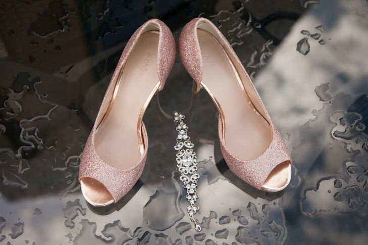 Natalie wore pink sparkly peep toe heels, giving her style a touch of romantic glam.