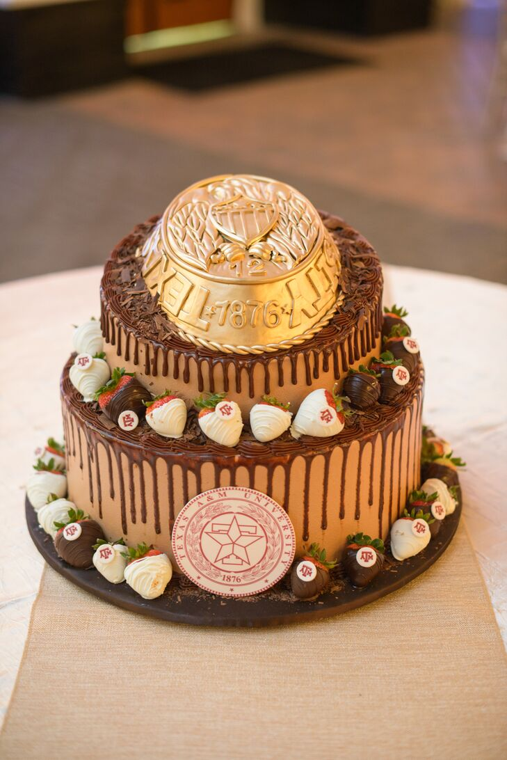A nod to their alma mater, Alex's groom's cake featured a tier shaped like the gold Texas A&M ring! Chocolate drizzle and chocolate-covered strawberries surrounded the other tiers, with other edible Aggie embellishments to continue the theme.
