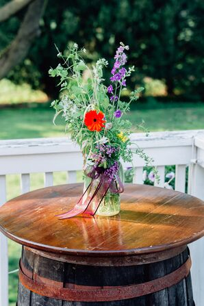 Barrel Cocktail Table With Wildflower Centerpiece