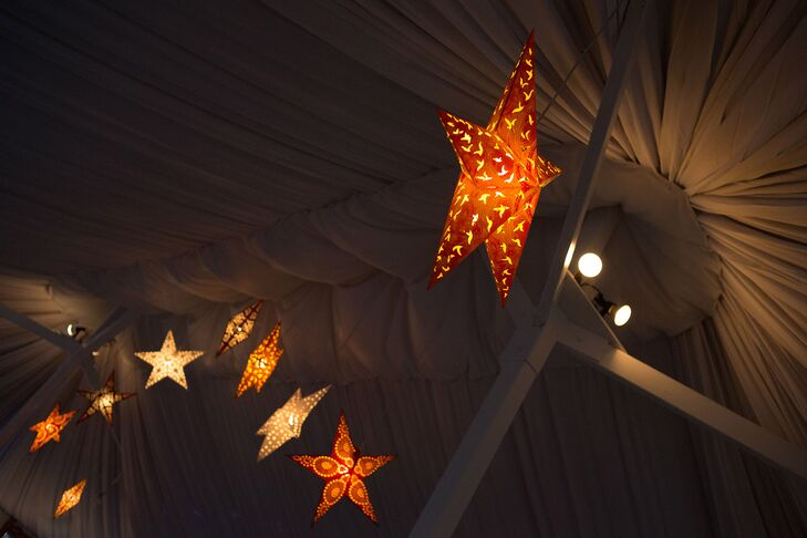 Large paper-star lanterns were strung above the tables at the tented reception.