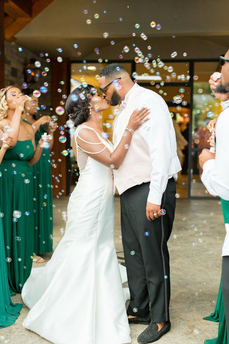 Couple Kisses During Bubble Grand Exit at Stone River in Columbia, South Carolina