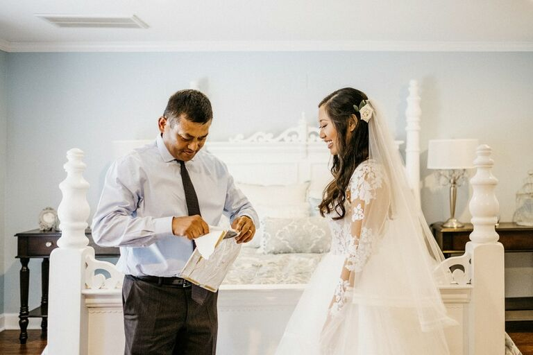 Bride giving her father a wedding-day gift