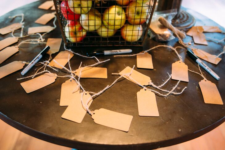 """As a nod to the bride's heritage, the couple had a Dutch wishing tree where guests could write a wish for the newlyweds and hang them on the tree. """"At Christmas we took all the wishes and hung them up as decorations and we plan to do that every year!"""" says Pattie."""