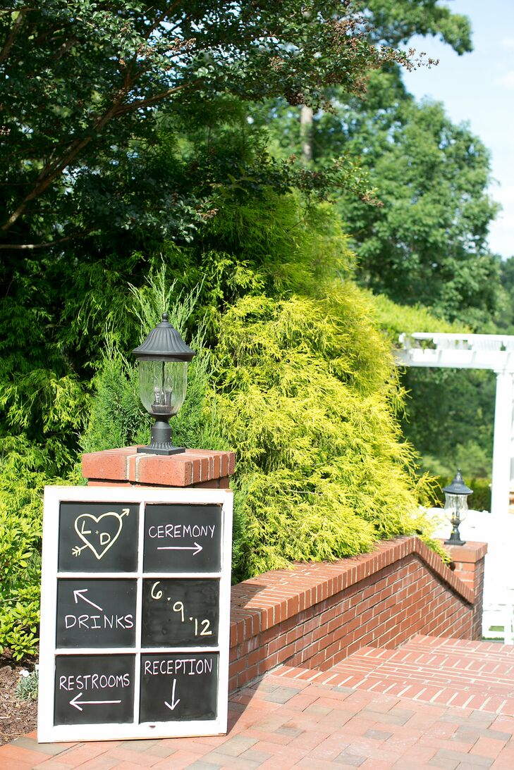 Lindsay and Dryw painted the glass of an old window with chalkboard paint and placed it at the ceremony entrance to direct guests around the estate.