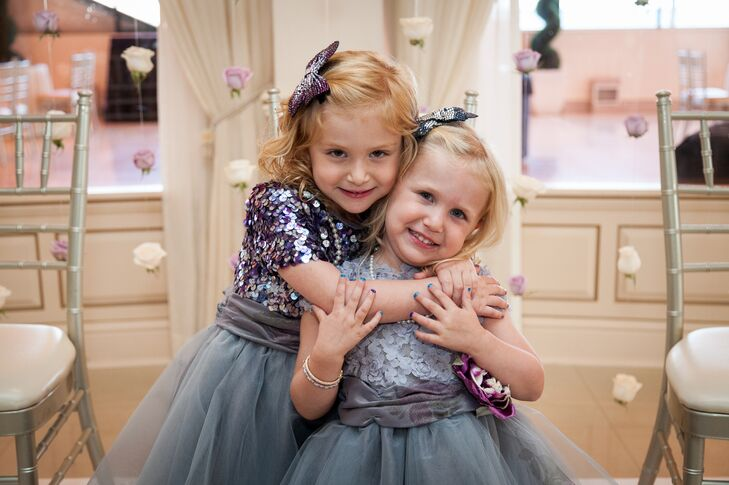 A glitzy dress can work with any wedding style. The flower girls wore blue-gray dresses with sequin or lace applique-covered tops and full tulle skirts. If that's not enough, they even wore sequin butterfly hair clips.