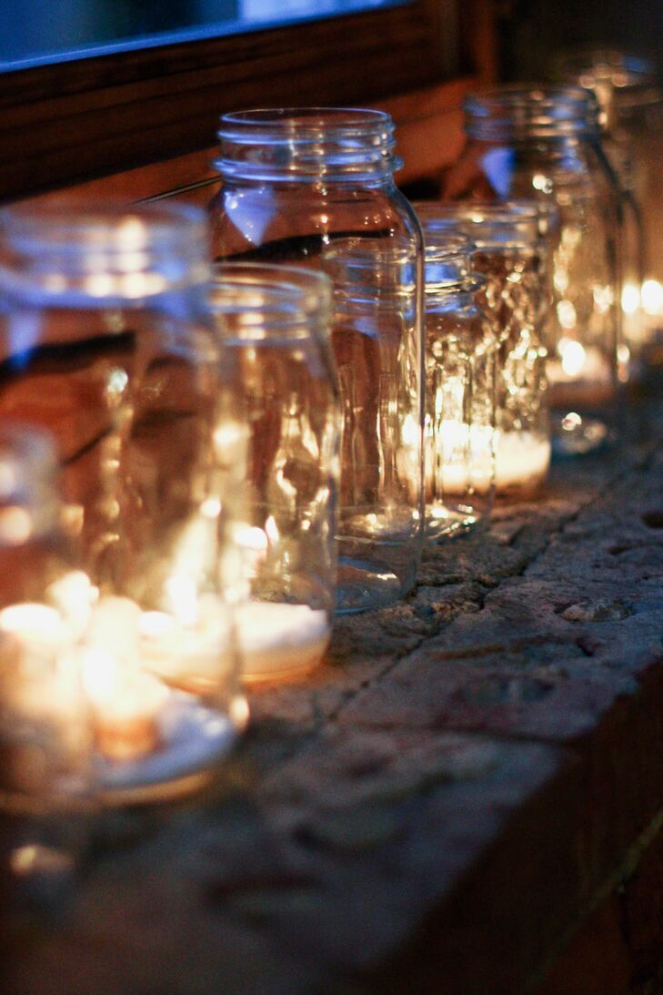 Mason jars with candles in them lined the tables at the reception, creating a warm glow.