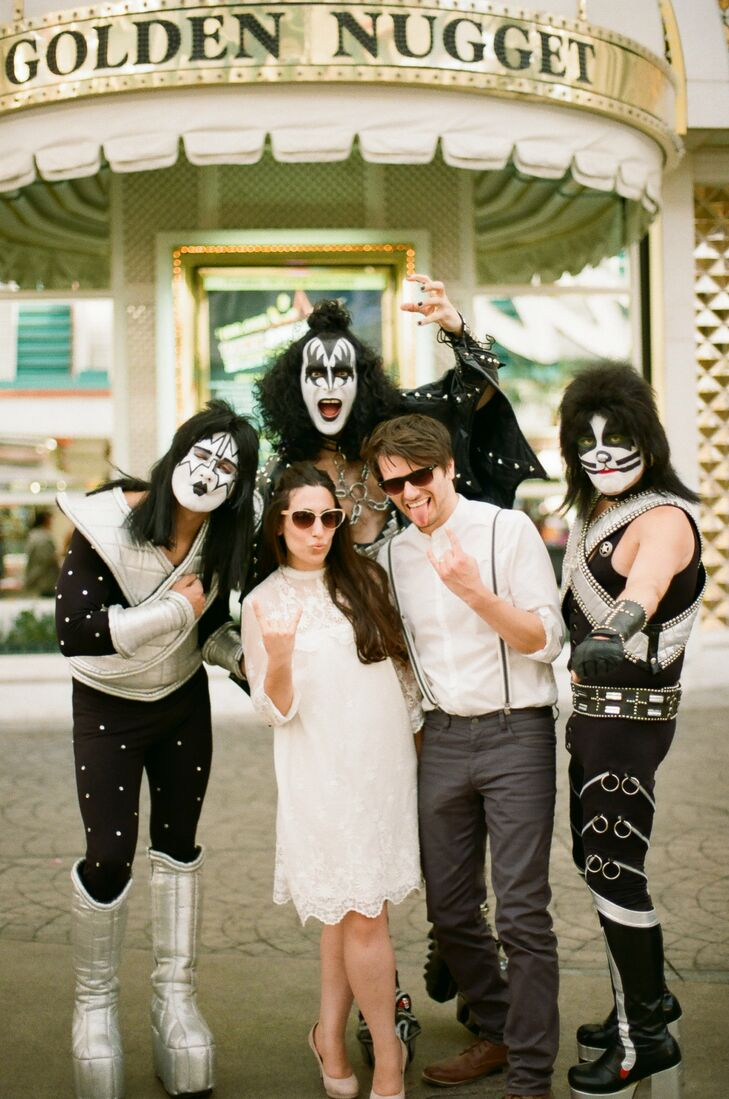 Leila and Tom posed for a fun photo with Kiss impersonators in Vegas. Leila's short lace dress was from H&M while Tom rocked a simple white shirt with skinny suspenders.