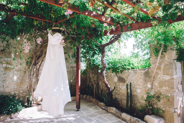 """Rachel has always dreamed of wearing a simple, lace dress on her wedding day but fell in love with this satin dress. """"It was a complete bargain!"""" she says."""