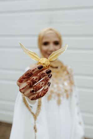 Bride Holding Harry Potter-Inspired Snitch at New Jersey Wedding