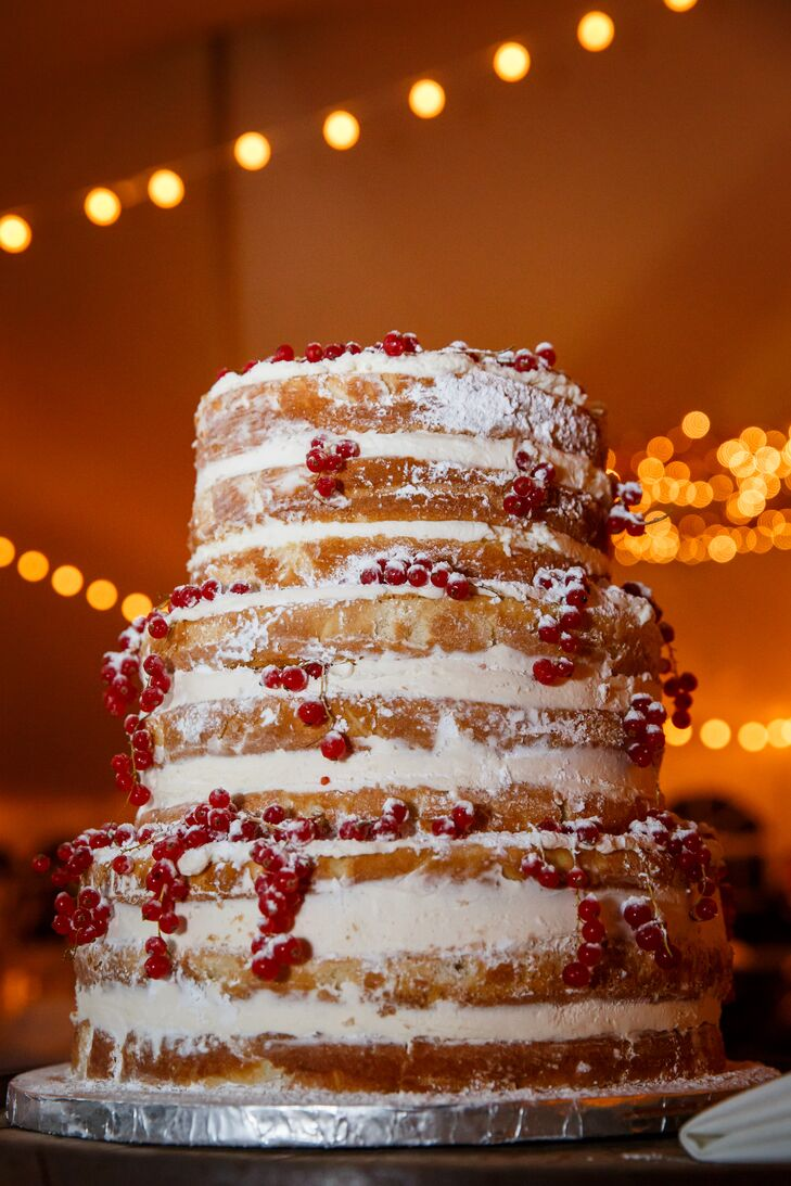 "Chicago-based bakery The Sugar Path created this three tier, naked came using fresh berries and whipped cream. Drizzled with powdered sugar and topped with red currants, it was the perfect cake for newlyweds Panthea and Thomas. ""It wasn't easy to find someone who would accommodate our wishes to bake a less traditional wedding cake,"" the bride explains. ""Luckily, the staff at The Sugar Path didn't hesitate to do so!"""