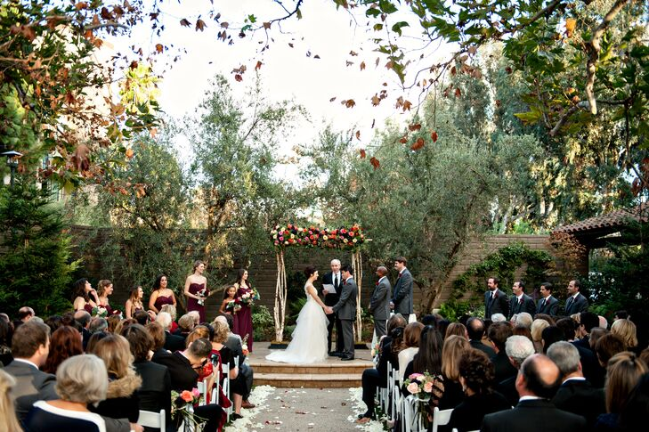 Under the shade of old-growth sycamore trees, Lauren and Phil exchanged heartfelt vows as their family and friends looked on. The pair gathered their guests in the Garland's Beverly Park, a quaint urban oasis complete with a refined stone fountain, cozy fireplace, lush flora and beautifully manicured lawns.