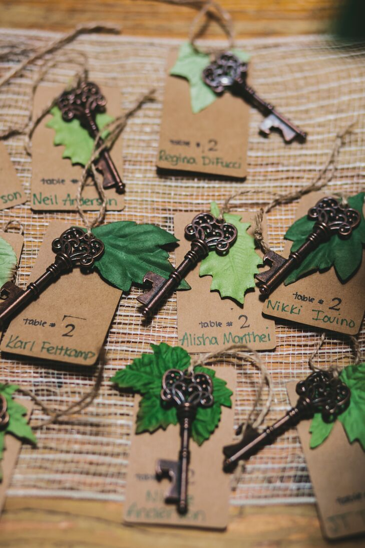 DIY escort cards incorporated vintage keys that doubled as bottle openers, along with handwritten cards and green paper leaves that were attached with twine.