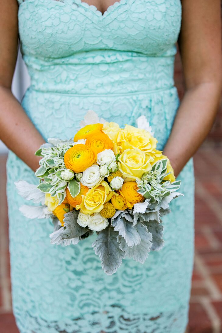 The bridesmaids all held yellow and white bouquets filled with ranunculus, roses, yellow crapsedia and dusty miller. The flower arrangements created a nice pop of color against their mint lace dresses.