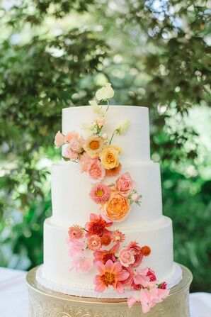 Three-Tier Wedding Cake with Cascade of Colorful Flowers