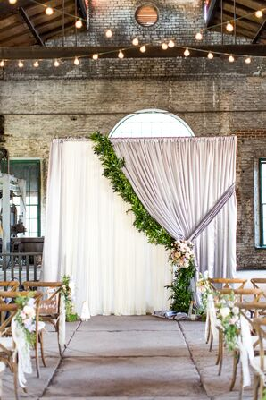 Bohemian Altar with Curtains and Greenery in Industrial Venue