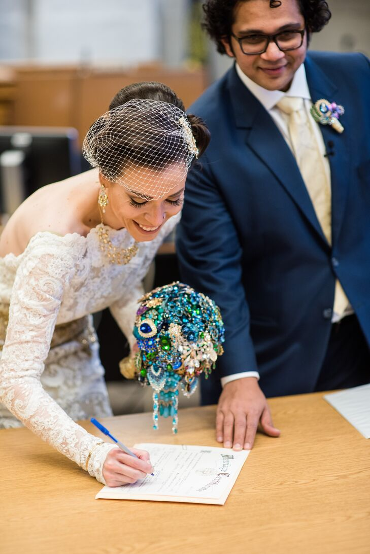 Jessica and Chintan sign their official marriage certificate after exchanging traditional wedding vows at Portland's Multnomah County Courthouse.