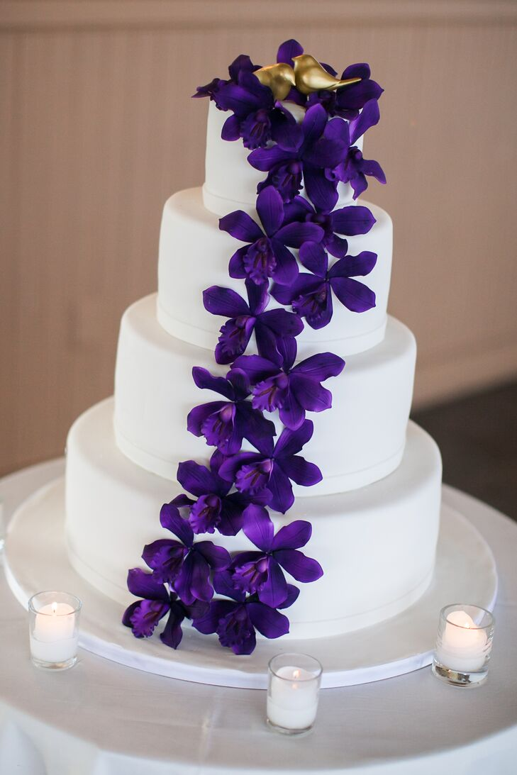 Four-Tier Wedding Cake With Purple Flowers