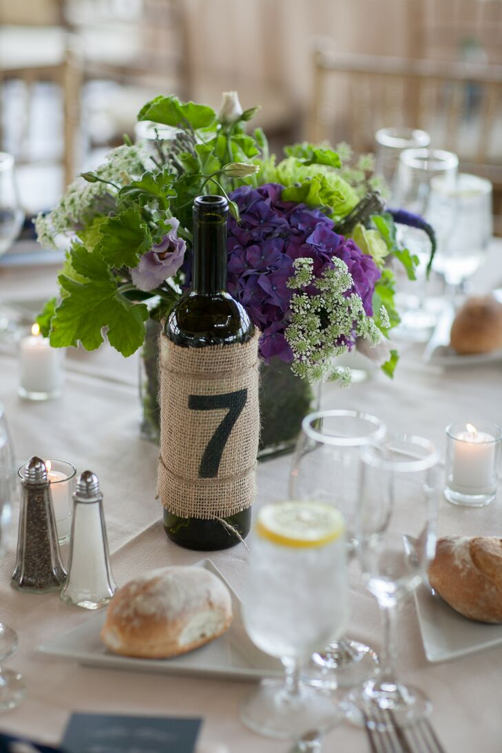 Lauren and Richard are both creative people and wanted to create a lot of the decor used at their wedding. They created their table numbers using wine bottles with burlap and stenciled numbers.