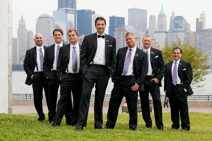 Richard and his groomsmen wore classic black tuxedos from Men's Wearhouse. While Richard wore a black bow tie, his groomsmen wore lavender ties that paired perfectly with the navy bridesmaid dresses and the blue and purple flowers used throughout the day.