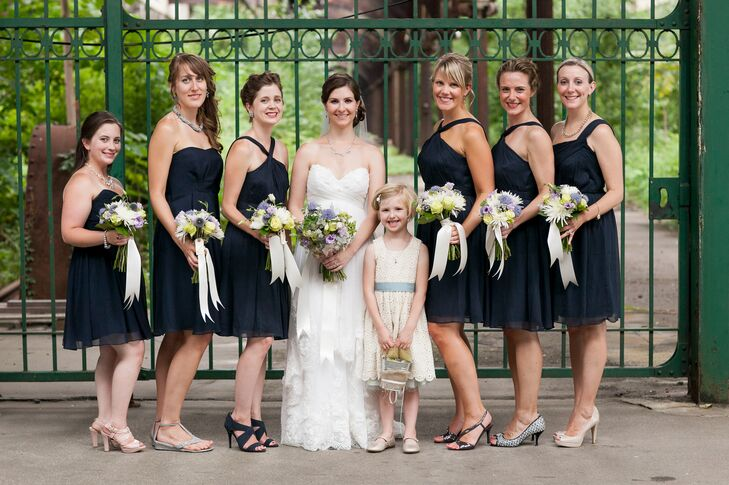 "Lauren chose navy chiffon dresses from J.Crew for her bridesmaids to wear, with the hope that they could wear their dresses again. ""I think they ended up looking fantastic,"" she says. ""Also most of the girls have worn their dresses again, so I feel like that's a win."""