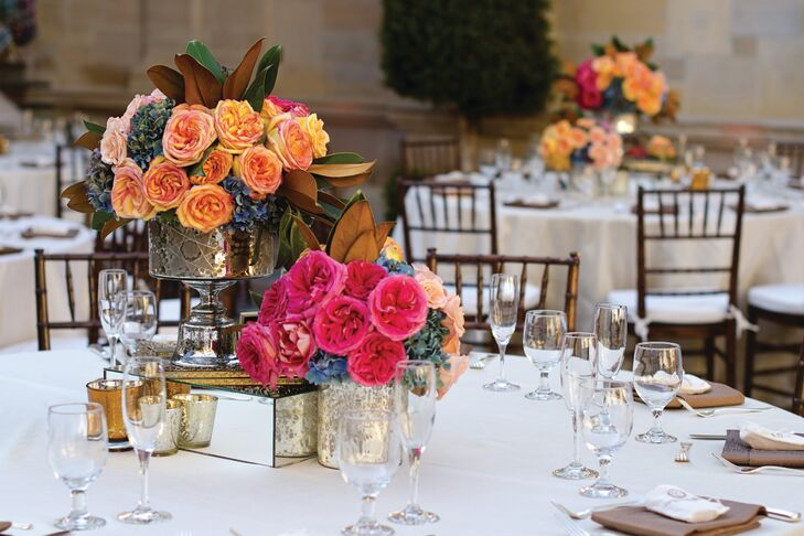Small centerpieces were made from antique jewelry boxes and placed on mirrored pedestals. Gold and silver votives shimmered beside them.