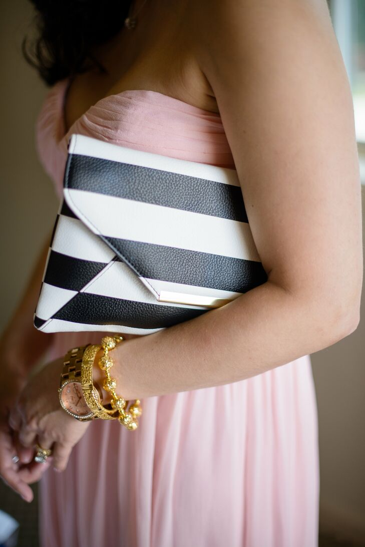 Clare set the tone for her black and white strip motif by having her bridesmaids carry preppy clutches with their pink Donna Morgan dresses.