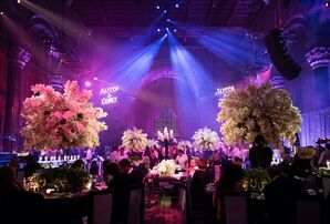 Glamorous Reception with Tall Orchid Centerpieces and Multicolored Lighting