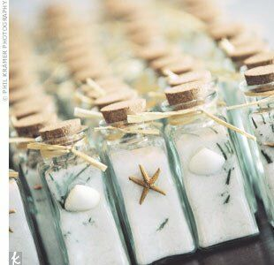 Glass spice bottles decorated with starfish and seashells had been filled with homemade rosemary-infused sea salts and were passed around as favors. As a final farewell, friends and family tossed rose petals from baskets labeled Love Is in the Air as Missy and Jeff escaped.