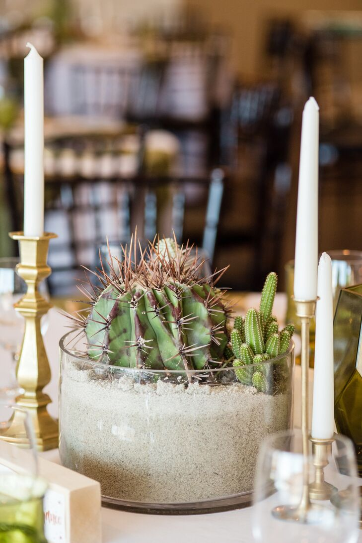 Keeping with the desert theme, each reception table was topped with copper- and gold-hammered bowls, which were filled with various cacti and sand.