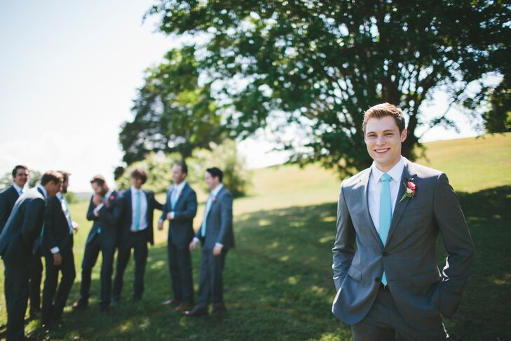 With Jess's help, Dan picked out a charcoal gray Hugo Boss suit. He paired his suit with a light blue tie, as did the groomsmen. The blue accessory tied into wedding day color scheme.