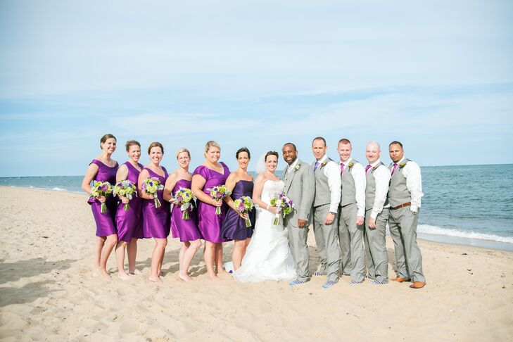 Michael's groomsmen wore gray vests that matched his suit. They also wore purple chrysanthemum boutonnieres and purple ties that matched the bridesmaid dresses.