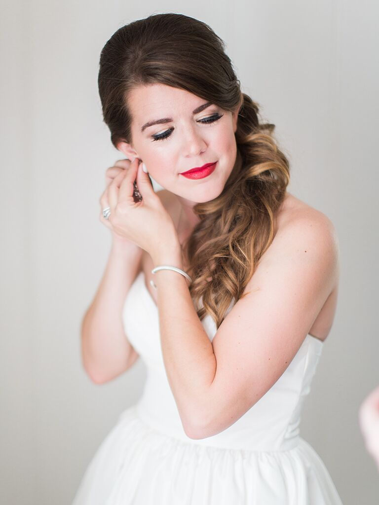 Sideswept and curled wedding day hairstyle