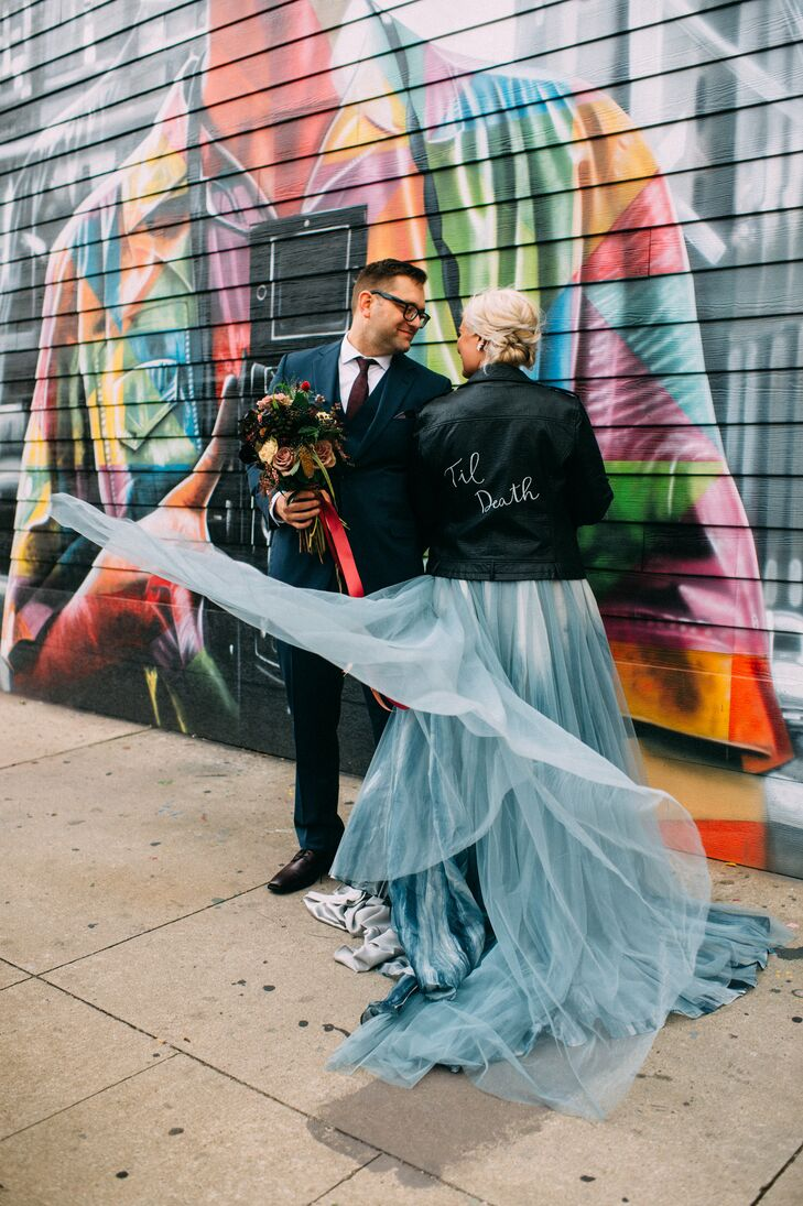 Edgy Bride Wearing Blue Tulle Skirt and Personalized Leather Jacket