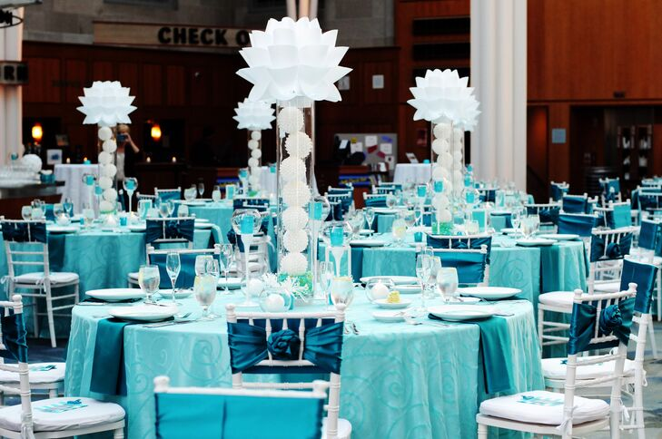The Indianapolis Public Library was transformed to an elegant and bold reception space thanks to bright linens and towering geometric centerpieces.