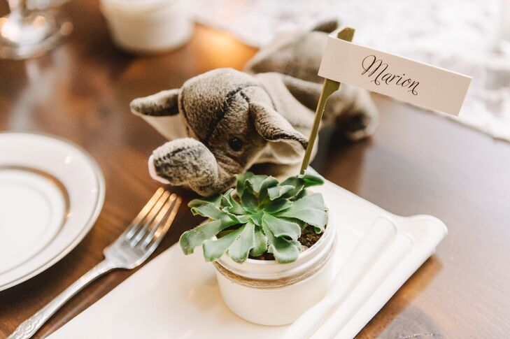 Guests found their seats marked with their names on small white labels, which stuck out from potted succulents set on top of white napkins.