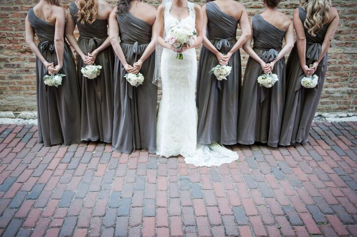 Each of Katelyn's bridesmaids wore a slate gray asymmetrical, floor-length dress.