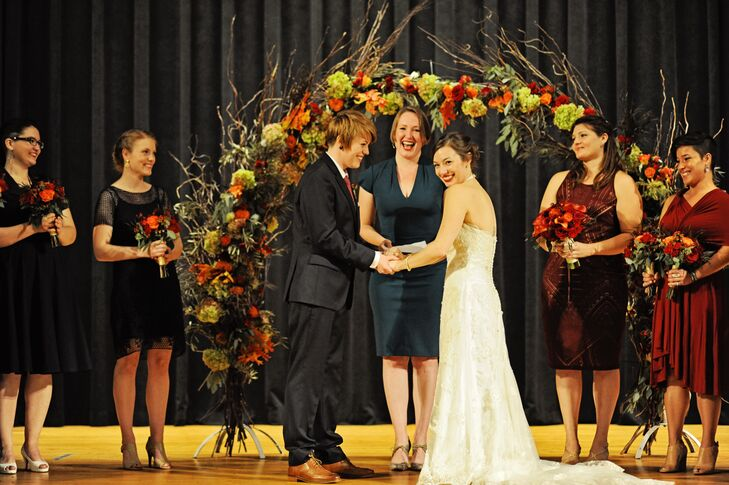 The pair exchanged vows in a ceremony officiated by their best friend under an arch made from olive branches, oak leaves, antique hydrangeas and roses.