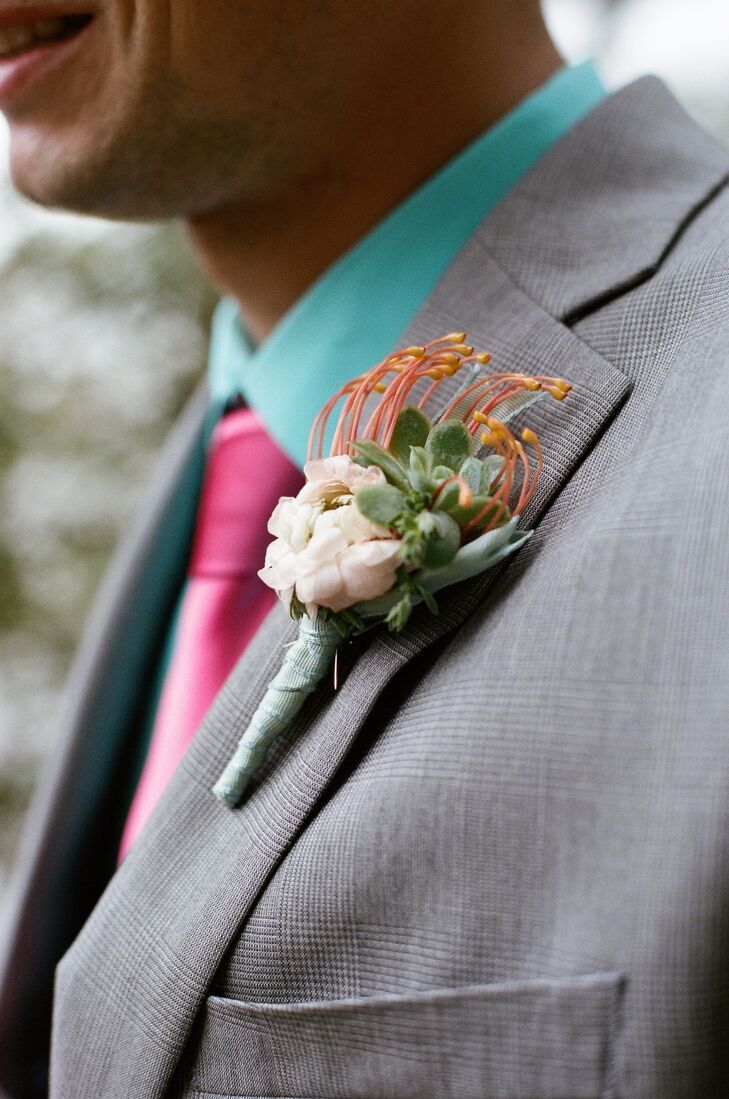 Mickey wore a unique boutonniere that paired a pincushion protea with a small succulent and zinnia.