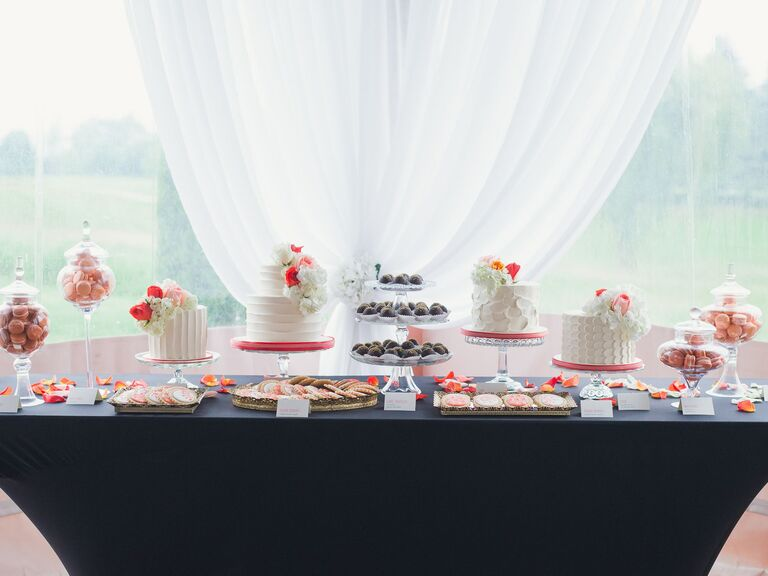 Wedding dessert table with cake and macarons