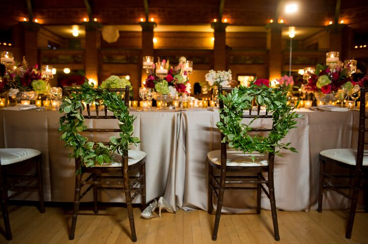 Two wreaths made entirely of greenery marked Katherine and Eric's seats at the head table.
