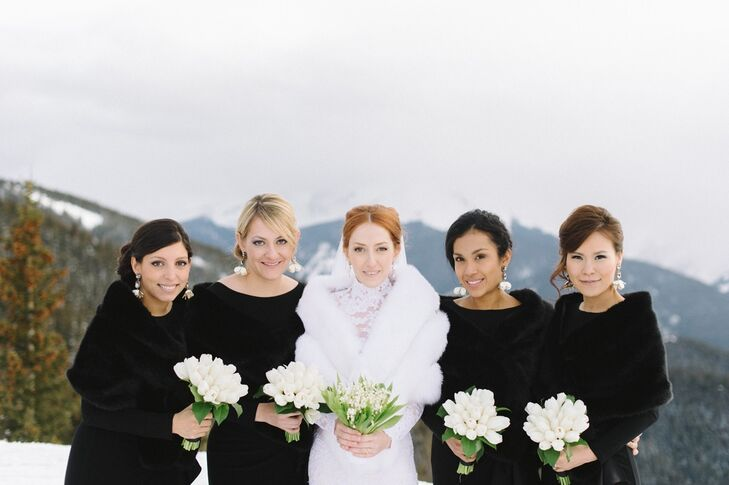 The bridesmaids wore long-sleeve jersey gowns with silk charmeuse cascade ruffles.