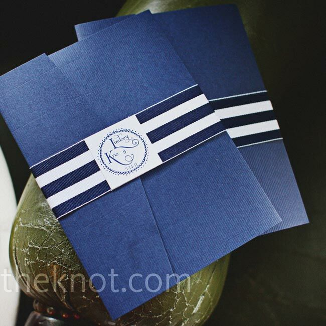A bold, striped belly band added a graphic look to the blue invitation pockets.